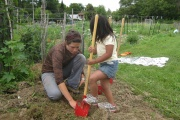 A CGW member working with a girl in the Garden Fit program.