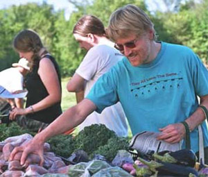A person at the CSA member farmstand.