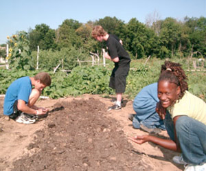 Youth working in the garden.